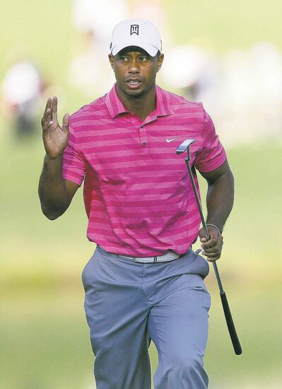 Tiger Woods mustered a wave on 18, but was far from happy.
