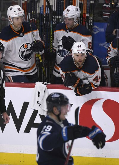 Fred Greenslade / The Canadian Press files</p><p>Oilers' Zack Kassian watches as Jets' Patrik Laine celebrates his winning shootout goal Sunday.</p></p>