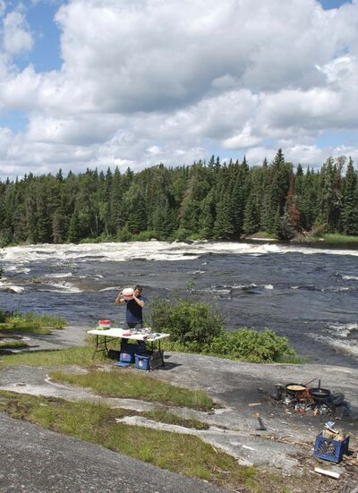 We listened to the roar of the rapids as Tobias Becker prepared a terrific shore lunch.</p>