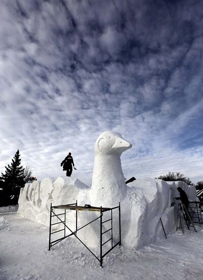 PHIL HOSSACK / WINNIPEG FREE PRESS</p><p>Local sculptors finish up a giant snow goose which will serve as the main gate to the Festival du Voyageur at Whittier Park.</p>