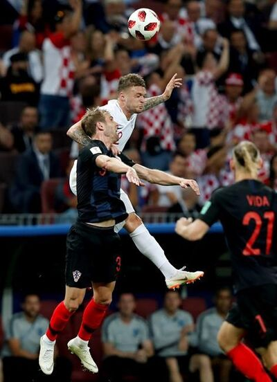 England's Kieran Trippier, right, challenges for the ball with Croatia's Ivan Strinic during the semifinal match between Croatia and England at the 2018 soccer World Cup in the Luzhniki Stadium in Moscow, Russia, Wednesday, July 11, 2018. (AP Photo/Rebecca Blackwell)