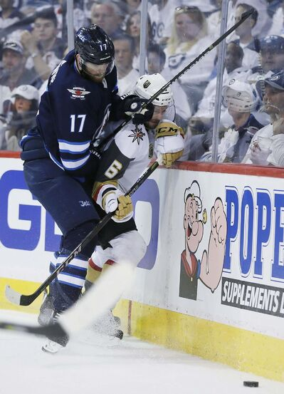 JOHN WOODS / THE CANADIAN PRESS</p><p>Winnipeg Jets&#39; Adam Lowry (17) checks Vegas Golden Knights&#39; Colin Miller (6) during second period of game one action in the NHL Western Conference Final in Winnipeg on Saturday, May 12, 2018.</p>