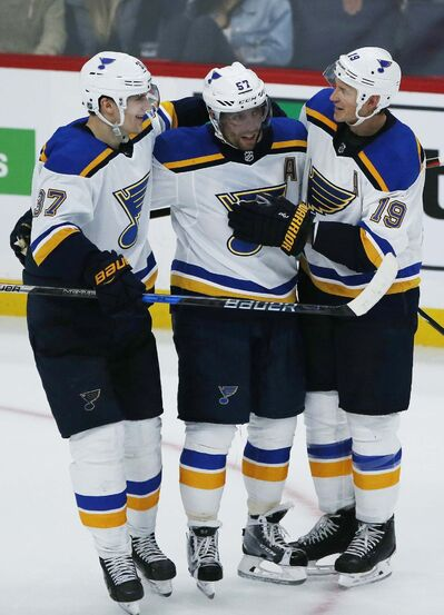 <p>St. Louis Blues Klim Kostin (37), David Perron (57) and Jay Bouwmeester (19) celebrate Perron's game winning goal against the Winnipeg Jets in overtime NHL action in Winnipeg on Friday.</p>