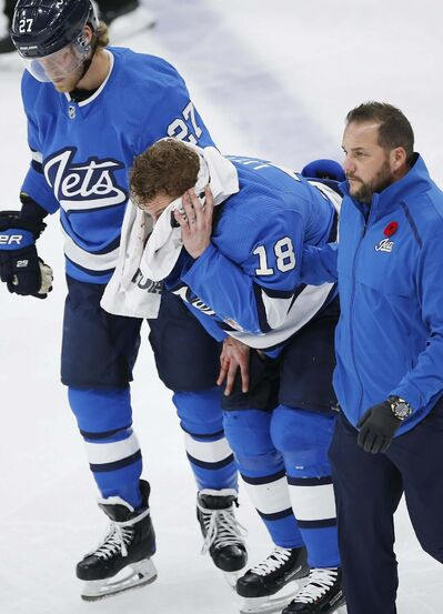 JOHN WOODS / WINNIPEG FREE PRESS</p><p>Jets forward Bryan Little is helped off the ice Tuesday after getting hit by a puck.</p>