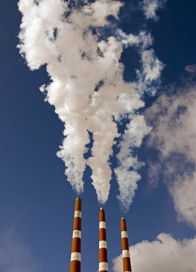 Emissions rise from Nova Scotia Power's Tuft's Cove Generating Station in Dartmouth in 2007. The plant burns oil and natural gas to produce electricity. Should Manitoba build its own gas power plant?