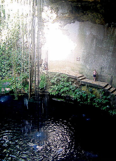Testing the water at the Ik-Kil cenote, near Chichen Itza.