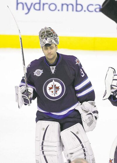 Ondrej Pavelec salutes the crowd at game's end.