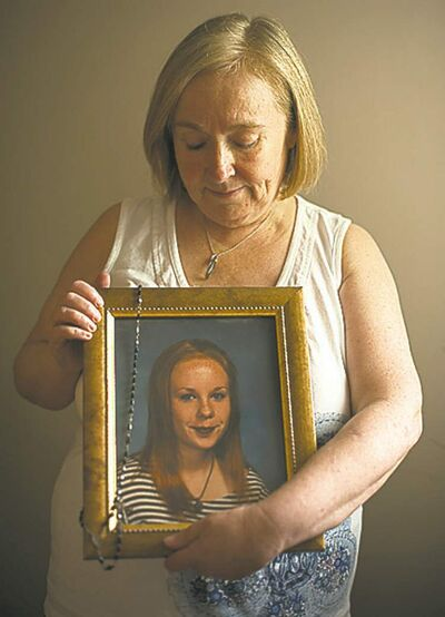 Photo by Cole Breiland/ Winnipeg Free PressElaine Stevenson holds a portrait of her daughter Alyssa with her rosary draped over it as it hangs in the family home on June 1st, 2012. Stevenson got the rosary from her grandmother, whom Alyssa was very close with.