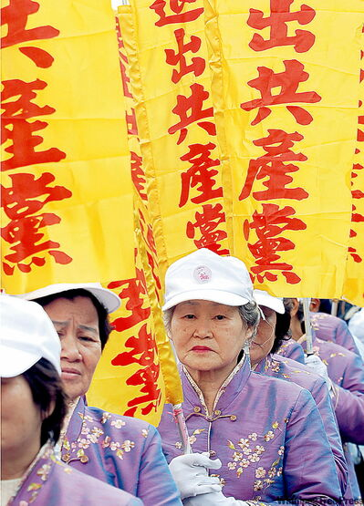 Falun Gong members march in Taipei, Taiwan.
