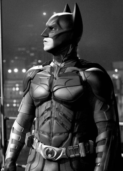 """FILE - In this file film image provided by Warner Bros., Christian Bale portrays Bruce Wayne and Batman in a scene from """"The Dark Knight Rises."""" The Dark Knight Rises"""" stayed atop the box office for the second straight weekend, making just over $64 million. But it's lagging behind the staggering numbers of its predecessor, 2008's """"The Dark Knight."""" (AP PHoto/Warner Bros., File) close cut closecut"""