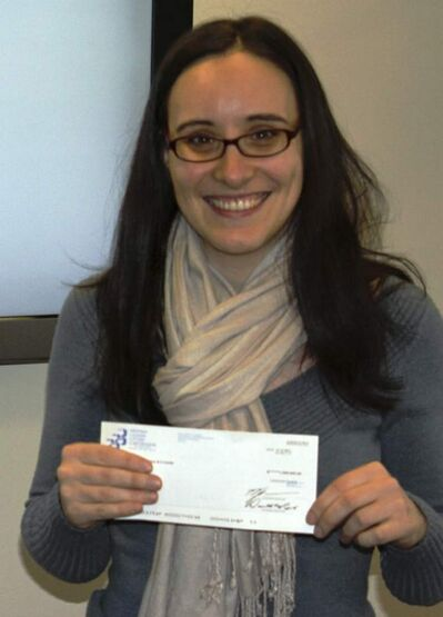 Sylvia Santos with  her big, fat cheque.