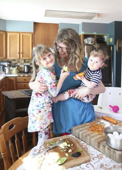 RUTH BONNEVILLE / WINNIPEG FREE PRESS</p><p>Alana Mazurak , mother of 10-month-old Juniper and five-year-old Ayla, gently guides her kids toward healthy eating.</p>