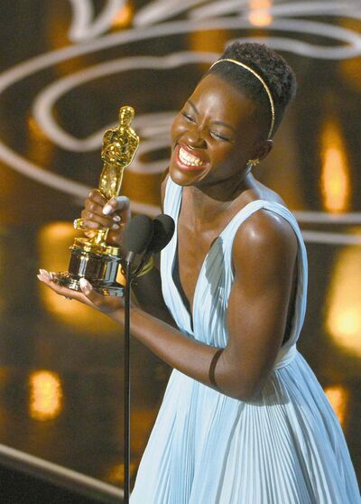 Lupita Nyong�o accepts the award for best actress in a supporting role for 12 Years a Slave during the Oscars Sunday.