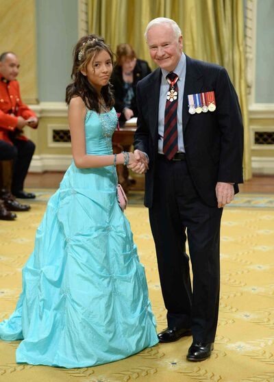 Gov. Gen. David Johnston presents the decoration of Bravery to Kina Raven Beardy of Cross Lake during a ceremony at Rideau Hall in Ottawa on Thursday.