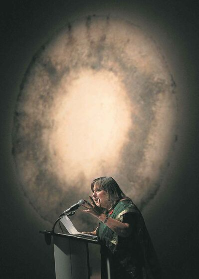 An emotional Gail Asper speaks while accepting the Mahatma Gandhi Peace Award Thursday.