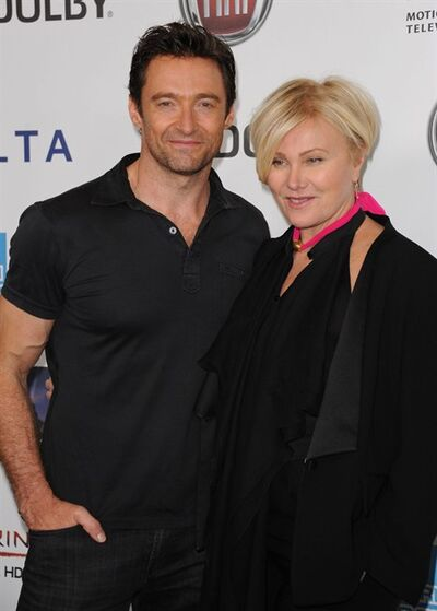 In this Saturday, Oct. 12, 2013 photo, Hugh Jackman, left, and Deborra-Lee Furness pose for photos at the Hugh Jackman One Night Only at the Dolby Theatre in Los Angeles. (Photo by Richard Shotwell/Invision/AP)