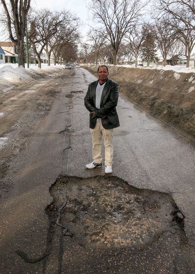 Driving school owner Richard Mutungi says slowing down and driving over a pothole is the best course of action.