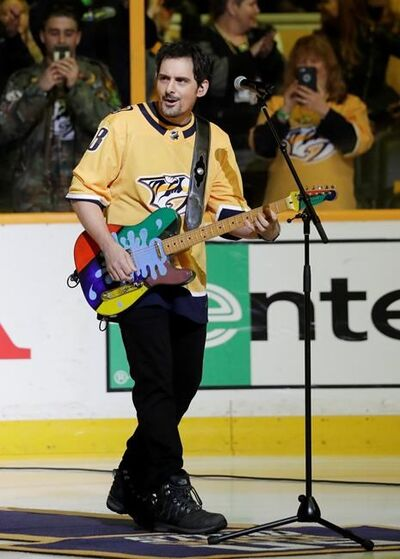 Brad Paisley performs the national anthem before Game 2 of an NHL hockey first-round playoff series between the Nashville Predators and the Colorado Avalanche, Saturday, April 14, 2018, in Nashville, Tenn. (AP Photo/Mark Humphrey)