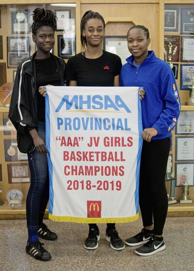 St. Norbert Collegiate's junior varsity girls basketball team was undefeated in its season, winning the AAA provincial basketball tournament on March 9. The team's captains — Mercy Lasu, Fatima Ibrahim, and Hannah Olugbodi — are pictured with the banner.