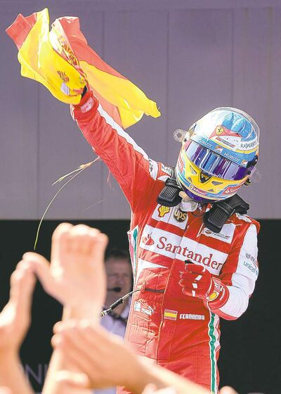 Ferrari's Fernando Alonso celebrates winning the Spanish Grand Prix Sunday, but said his team has work to do to catch leader Sebastian Vettel.