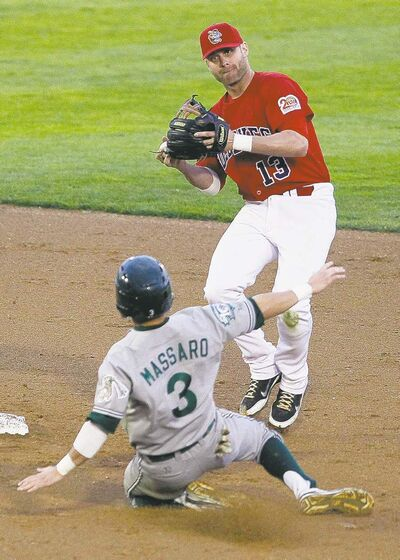 Goldeyes' Josh Mazzola (13) throws to first for the double play against Mike Massaro (3) and the Gary SouthShore Railcats in the fourth game of a series against the Gary SouthShore RailCats at Shaw Park Tuesday.