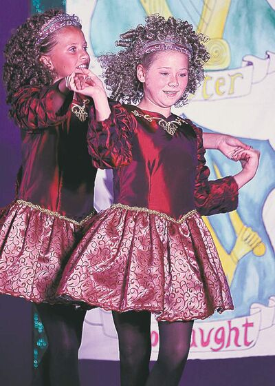 Young dancers perform in the Ireland-Irish Pavilion on Sunday.