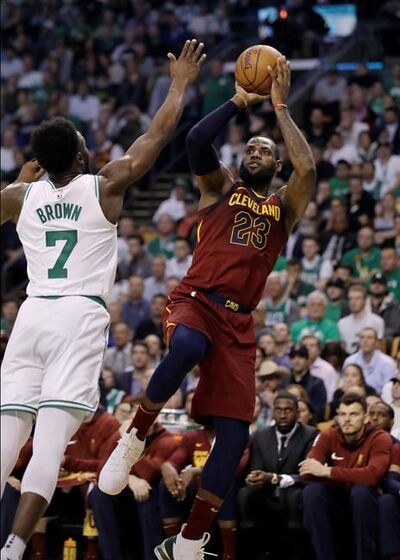 Cleveland Cavaliers forward LeBron James, right, shoots against Boston Celtics guard Jaylen Brown during the first half in Game 2 of the NBA basketball Eastern Conference finals, Tuesday, May 15, 2018, in Boston. (AP Photo/Charles Krupa)