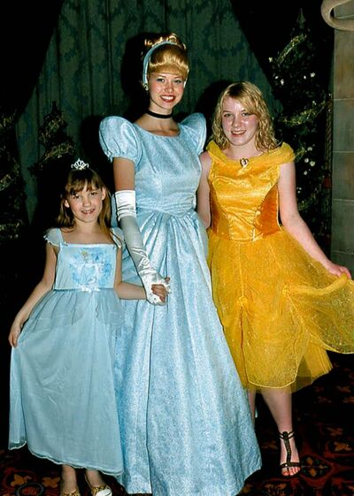 Maslen, 8,Cinderella and Beverley Lunney, 15, meet at Cinderella's Royal Table Princess Dinner in Cinderella's Castle at Disney World.