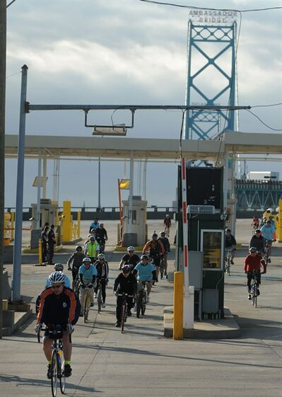 "One hundred and fifty cyclists pedaled their way across the Ambassador Bridge and throughout southwest Detroit, Sunday Oct. 13, 2013 during Tour de Troit's ""Bike the Bridge"" ride. (AP Photo/The Detroit News, Brandy Baker)"
