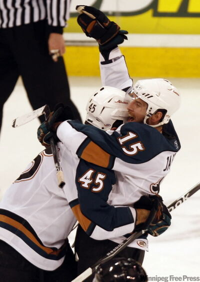 Manitoba Moose #15 Jason Jaffray is hugged by #45  Mark Fistric after scoring winning goal