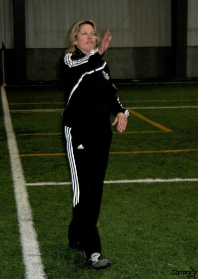 Adair Knock directs traffic as her provincial under-14 girls practise indoors. Knock is the second female coach in Manitoba to earn a National B licence.