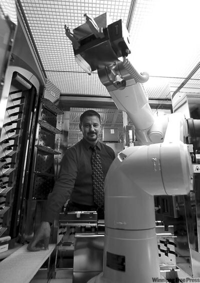Intelligent Hospital Systems' Thom Doherty with a hot-selling robotic pharmaceutical dispenser.