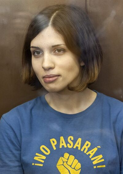 "FILE - In this Aug. 17, 2012 file photo, Feminist punk group Pussy Riot member Nadezhda Tolokonnikova sits in a glass enclosure at a court in Moscow, Russia. Federal Prison Service spokeswoman Kristina Belousova said Friday, Feb. 1, 2013 that Tolokonnikova is in a prison hospital in the province of Mordovia in western Russia, the site of her prison colony. Belousova refused to specify Tolokonnikova's illness or comment on her condition, saying only that she has ""nothing serious."" (AP Photo/Misha Japaridze, File)"