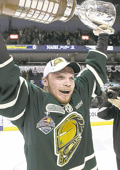 London Knights' Max Domi hoists the OHL championship trophy,