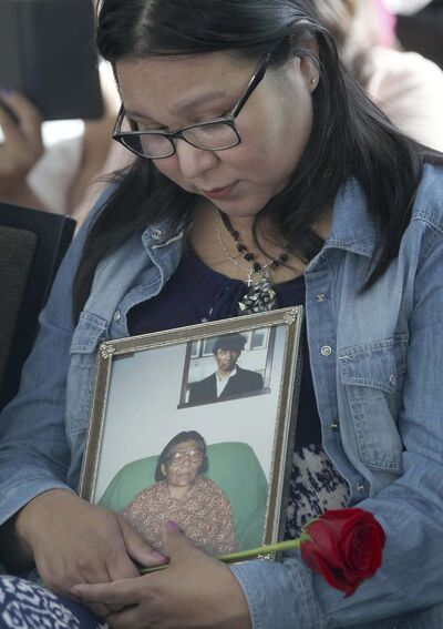 JOE BRYKSA / WINNIPEG FREE PRESS</p><p>Jennifer Tom of Tadoule Lake gets emotional holding a picture of her grandmother Mamie Tom who died of cancer in 1993.</p>