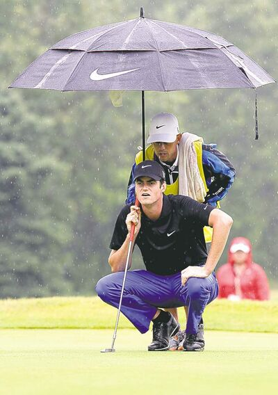 MIKE DEAL / WINNIPEG FREE PRESSMatt Hill and caddie Luke Riddly line up a shot on the 15th green in the final round of the Players Cup at Pine Ridge Sunday afternoon. Hill will be invited to the RBC Canadian Open next week in Hamilton.