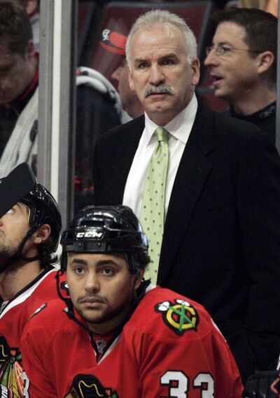 Byfuglien as a member of the Chicago Blackhawks on the bench with head coach Joel Quenneville, top, in 2009.</p>