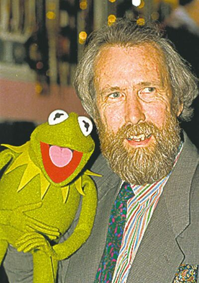 Jim Henson, creator of the Muppets, poses with one of his puppets, Kermit the Frog, in this February 1988 photo.