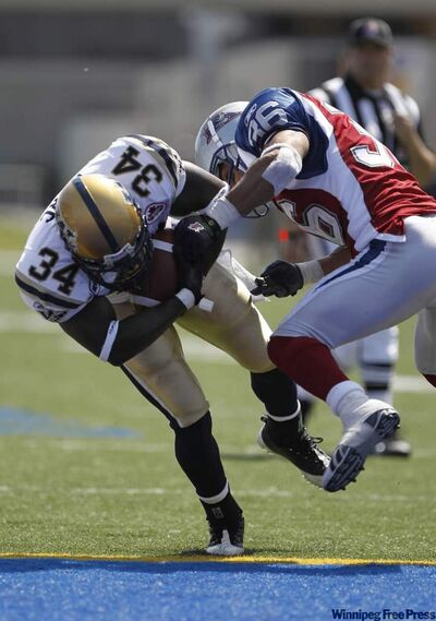 Winnipeg Blue Bomber Emmanuel Marc puts his head down and blasts through Steven Holness of the Montreal Alouettes to score during the Bomber 34-10 win Sunday in Winnipeg.