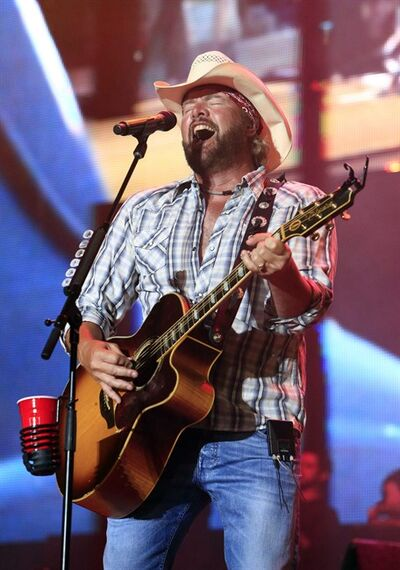 FILE- In this July 6, 2013, file photo, Toby Keith performs at the Oklahoma Twister Relief Concert at the Gaylord Family-Oklahoma Memorial Stadium in Norman, Okla. The tornado relief concert organized by Keith has raised $2 million that will go to a tornado relief fund run by the United Way of Central Oklahoma. (Photo by Alonzo Adams, File/Invision/AP, File)