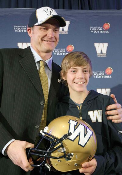 Winnipeg Blue Bombers new head coach Mike O'Shea is introduced with his 13-year-old son Mike at a news conference in downtown Winnipeg Wednesday.