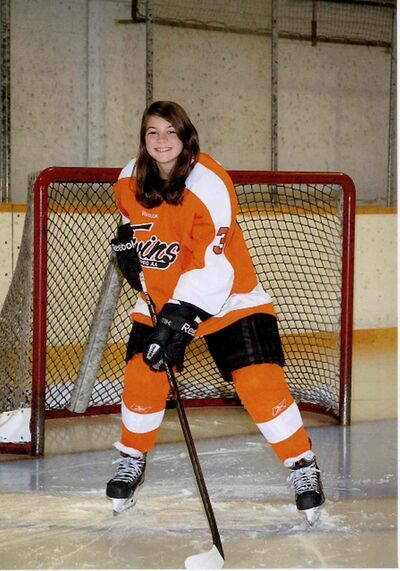 Stephanie Molloy, a 14-year-old Grade 9 student at Vincent Massey Collegiate, plays hockey for her school and for the AA Winnipeg Twins.