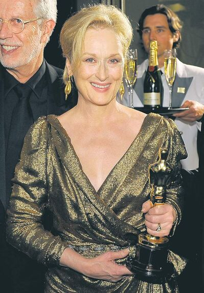 "Meryl Streep with the Oscar for best actress in a leading role for ""The Iron Lady"" at the Governors Ball following the 84th Academy Awards on Sunday, Feb. 26, 2012, in the Hollywood section of Los Angeles. (AP Photo/Chris Pizzello)"
