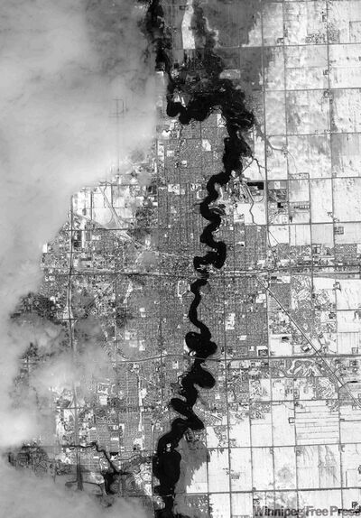 This black and white satellite image taken Sunday March 29 shows the Red River and areas of flooding in Fargo, N.D.