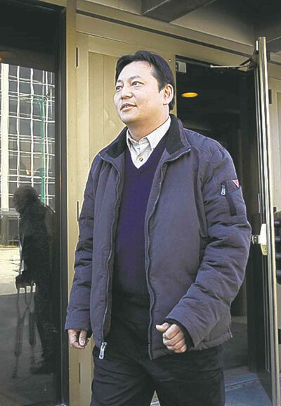 Joe Chan leaves the Manitoba Law Courts building last April.