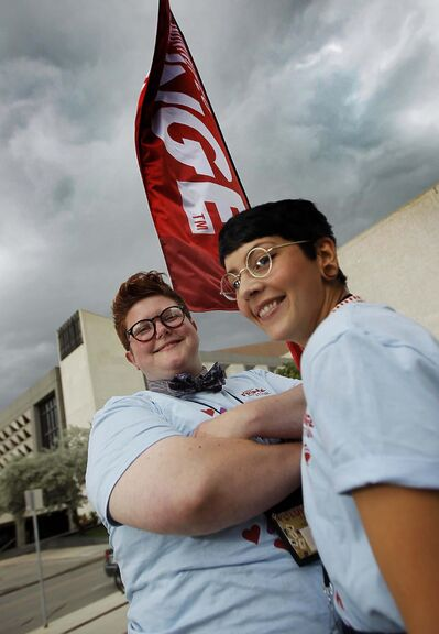 PHIL HOSSACK / WINNIPEG FREE PRESS</p><p>Saz Massey (left) and her partner, Bre Brown, volunteer at the Pantages Theatre during the Fringe on Thursday. Massey has been volunteering with the Fringe since she was a teenager.</p>