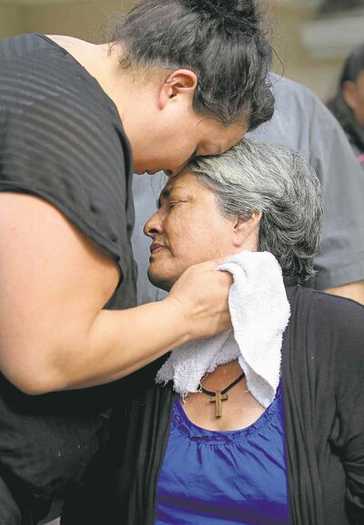 Thelma Favel is comforted by her daughter, Samatha Barto, after her grand-niece's funeral.