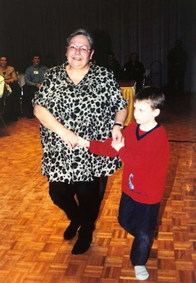 Patricia and her grandson dancing a polka.</p>