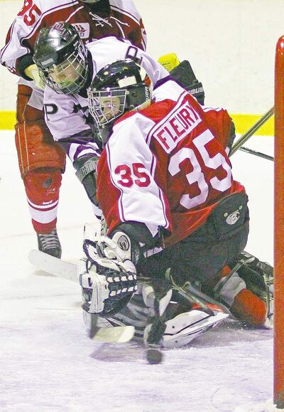 John Woods / Winnipeg Free PressKelvin Clippers goaltender Stu Fleury can only watch as a shot from St. Paul�s Crusaders Easton Oliver-Hanna finds the net in the third.