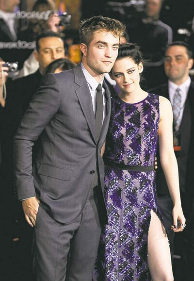 "Robert Pattinson, left, and Kristen Stewart arrive at the world premiere of ""The Twilight Saga: Breaking Dawn - Part 1"" on Monday, Nov. 14, 2011, in Los Angeles."